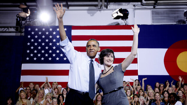 President Obama is accompanied by Sandra Fluke at a 2012 campaign event in Aurora, Colo. Fluke gained attention when talk show host Rush Limbaugh spoke disparagingly of her testimony before Congress on the issue of contraception and insurance coverage.