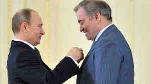 "Russian President Vladimir Putin (left) presents the ""Hero of Labour"" award to conductor Valery Gergiev, head of the Mariinsky Th"