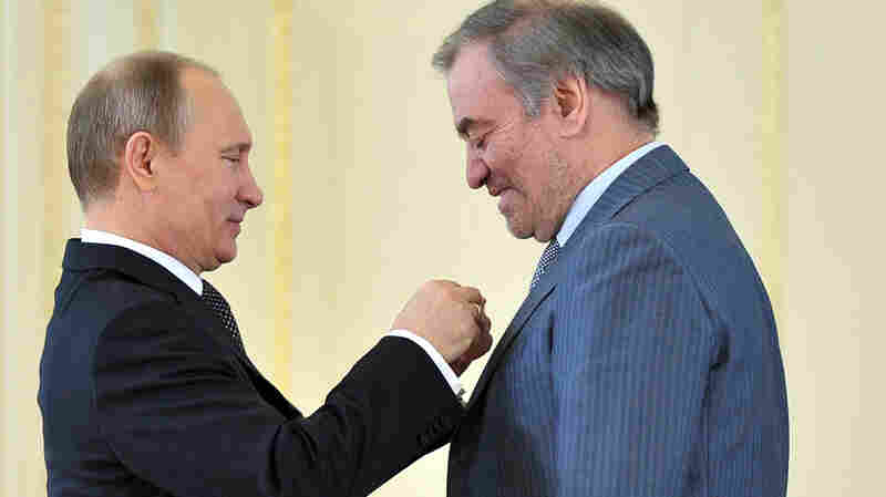 "Russian President Vladimir Putin (left) presents the ""Hero of Labour"" award to conductor Valery Gergiev, head of the Mariinsky Theatre."