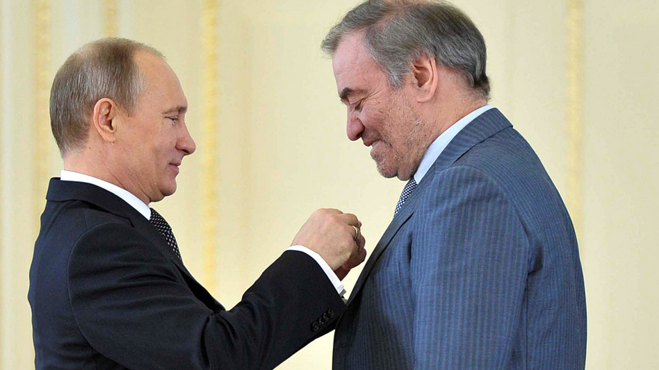 "Russian President Vladimir Putin (left) presents the ""Hero of Labour"" award to conductor Valery Gergiev, head of the Mariinsky Theatre. (AFP/Getty Images)"