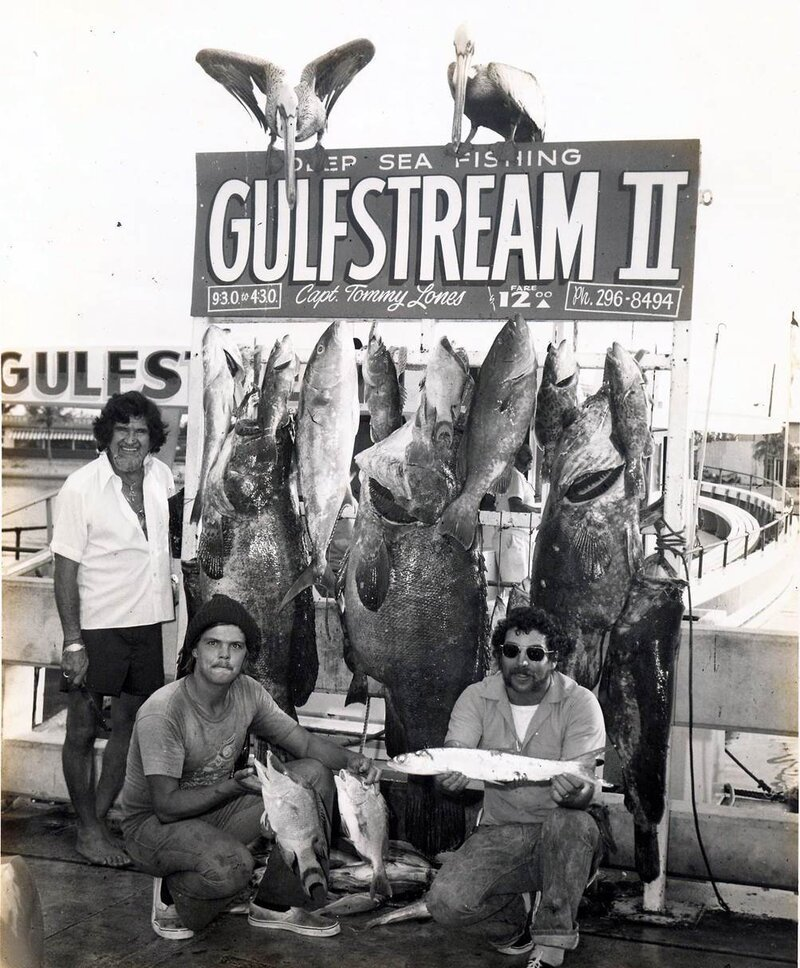 Even prize fish are smaller than the people who caught them in this photo from sometime between 1965 and 1979.