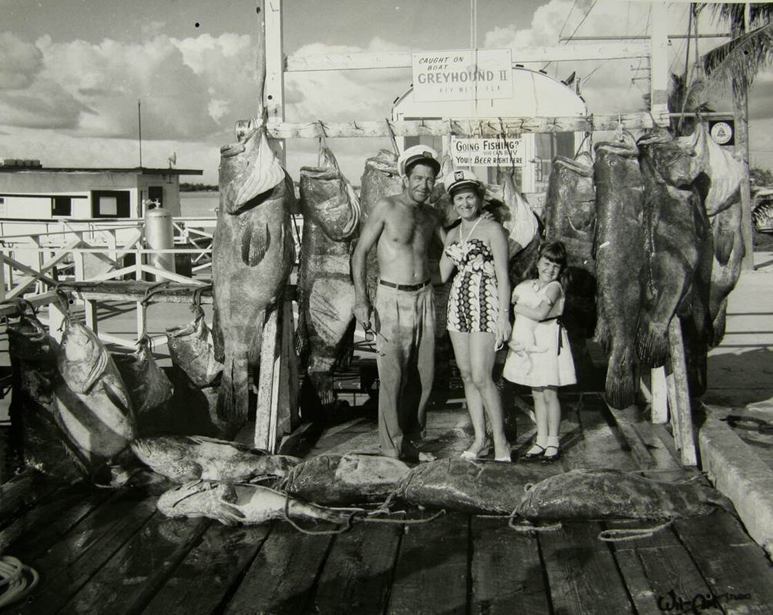 A proud fishing family in 1958 stands before several prizewinning fish much bigger than a human 5-year-old.