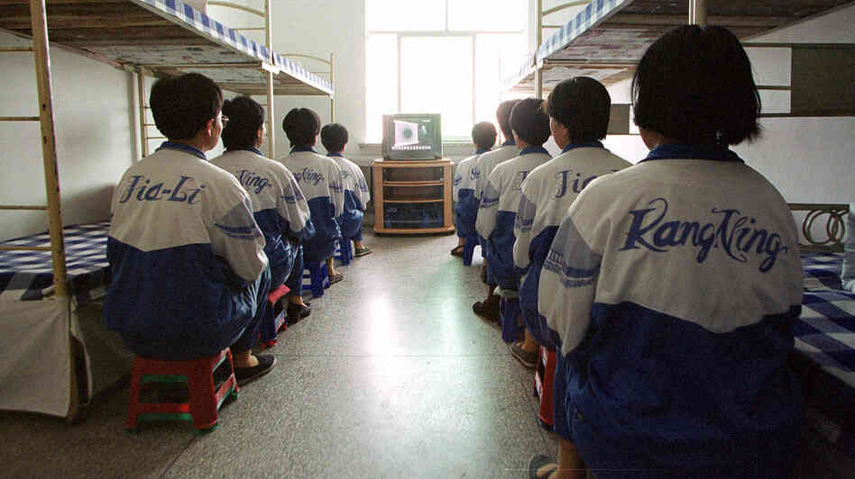 Falun Gong practitioners watch a video at the Masanjia re-education through labor camp in northeast China's Liaoning province on May 22, 2001.