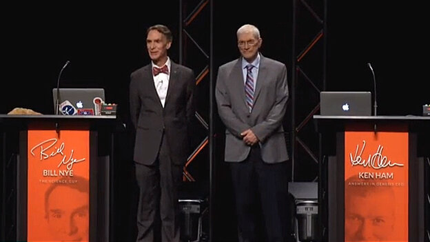Bill Nye, left, and Ken Ham take the stage to debate evolution and creationism Tuesday in Kentucky.