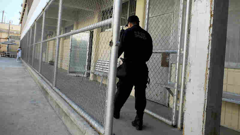 A Mexican guard at a prison in Tijuana where 17 men are being held on charges they were digging a drug-smuggling tunnel from Tijuana to the U.S. border at San Diego. The men say they were kidnapped and forced to do the work.