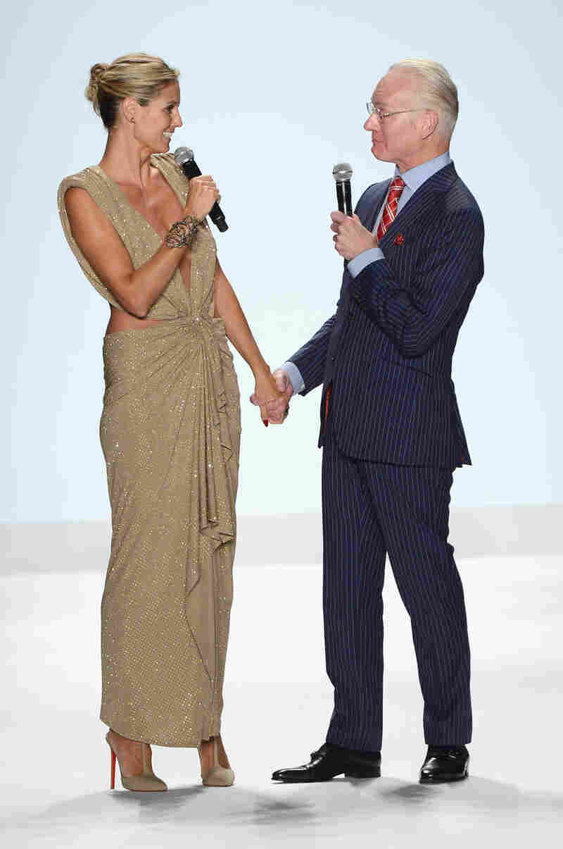 Heidi Klum and Tim Gunn walk the runway at the Project Runway spring 2013 fashion show in New York City in September 2012.