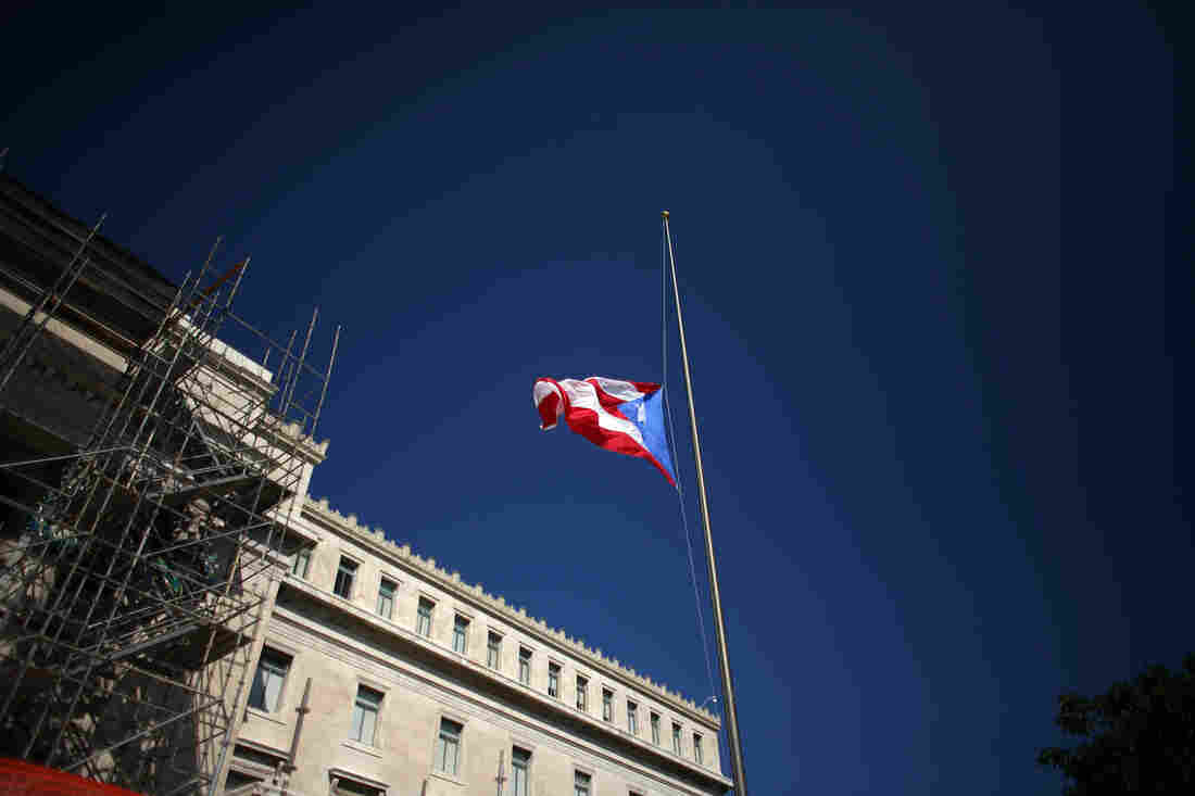 The Puerto Rican flag waves in front of the south wing of the Capitol in San Juan, Puerto Rico.
