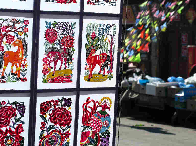 Intricate, hand-cut paper decorations are a popular handicraft in Nuanquan Town, especially during the New Year.