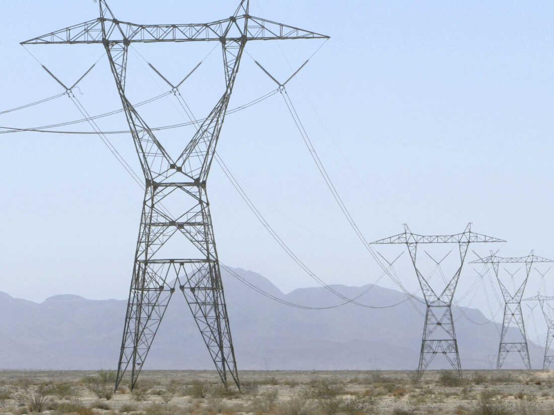 High voltage power lines cross through the California desert west of El Centro.