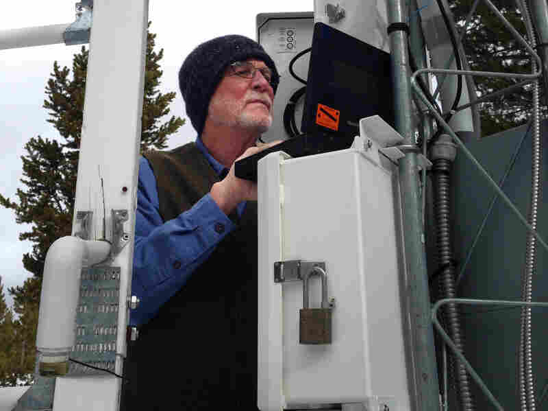 Frank Gehrke, chief of snow surveys in California, looks at wind speed, snow depth and moisture data collected at a survey site in Yosemite National Park.