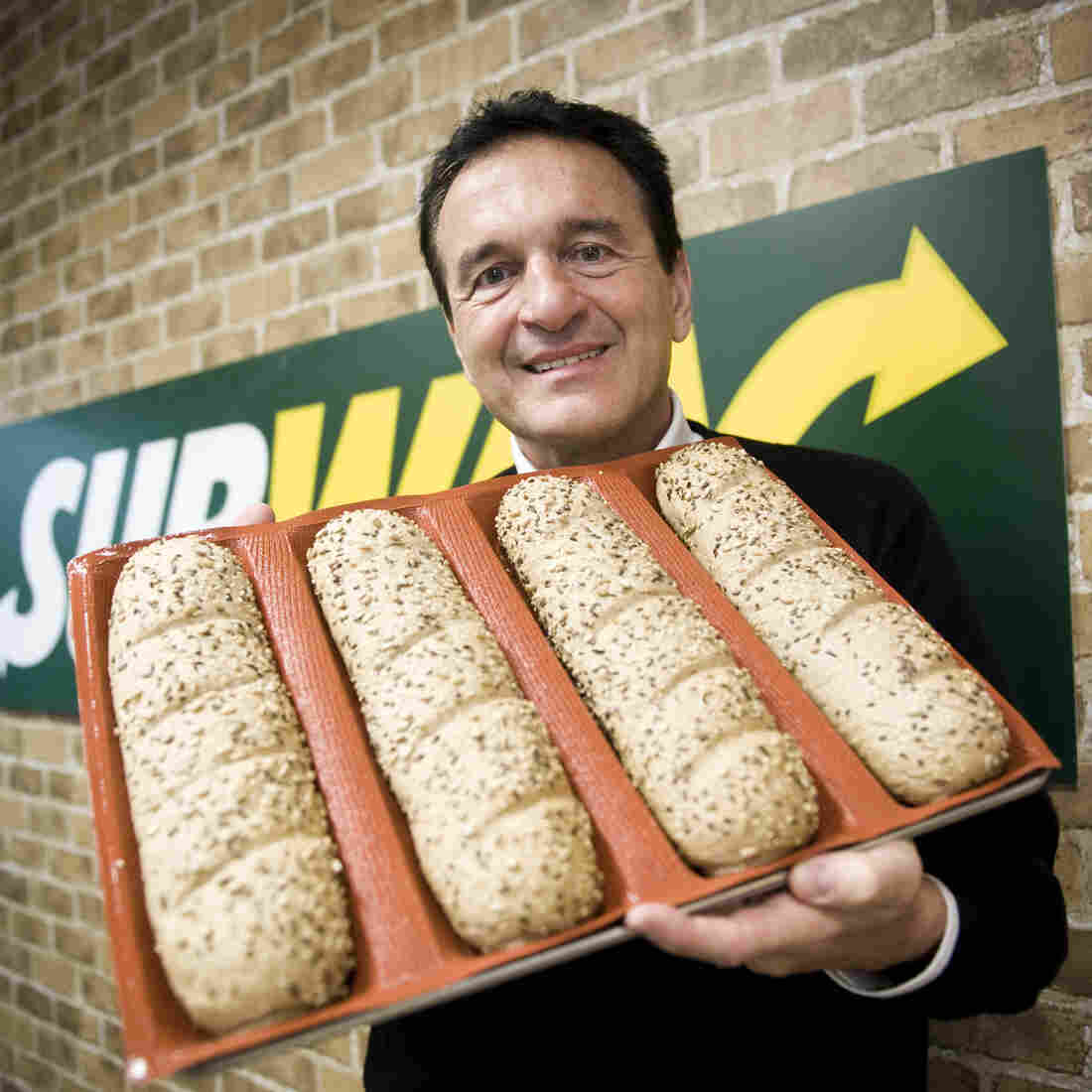 Sandwich chain Subway has announced plans to drop the additive azodicarbonamide from its fresh-baked breads. Above, Subway founder Fred DeLuca poses carrying bread for sandwiches.