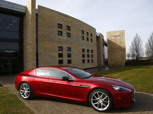 An Aston Martin Rapide S, one of the models affected by the recall, is displayed outside the Aston Martin production facility in Gaydon, England, i