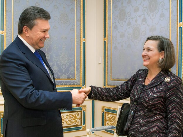 Ukrainian President Viktor Yanukovich greets Victoria Nuland, the U.S. assistant secretary of state for European and Eurasian affairs, in Kiev, Ukraine, on Thursday. In a tape posted on YouTube on Thursday, Nuland can be heard discussing the merits of various Ukrainian opposition leaders and disparaging the EU.