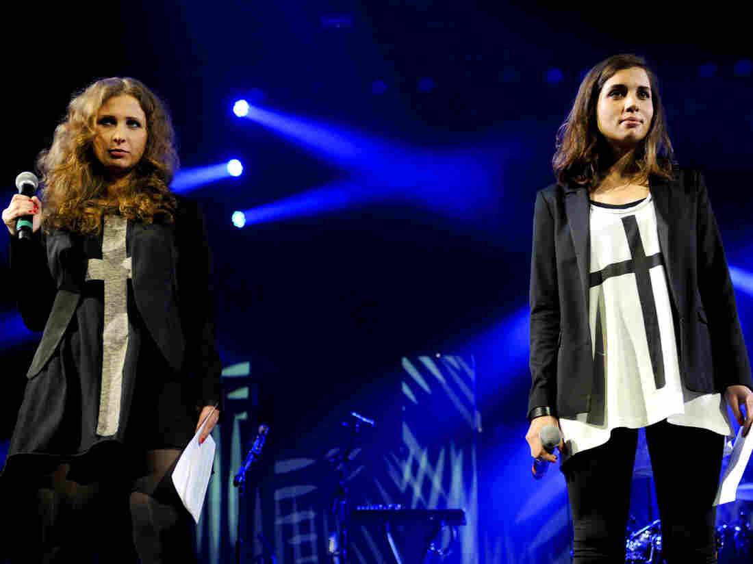 "Maria ""Masha"" Alyokhina (left) and Nadezhda ""Nadya"" Tolokonnikova of the Russian punk protest group Pussy Riot speak onstage at an Amnesty International concert in Brooklyn, N.Y., Wednesday night."