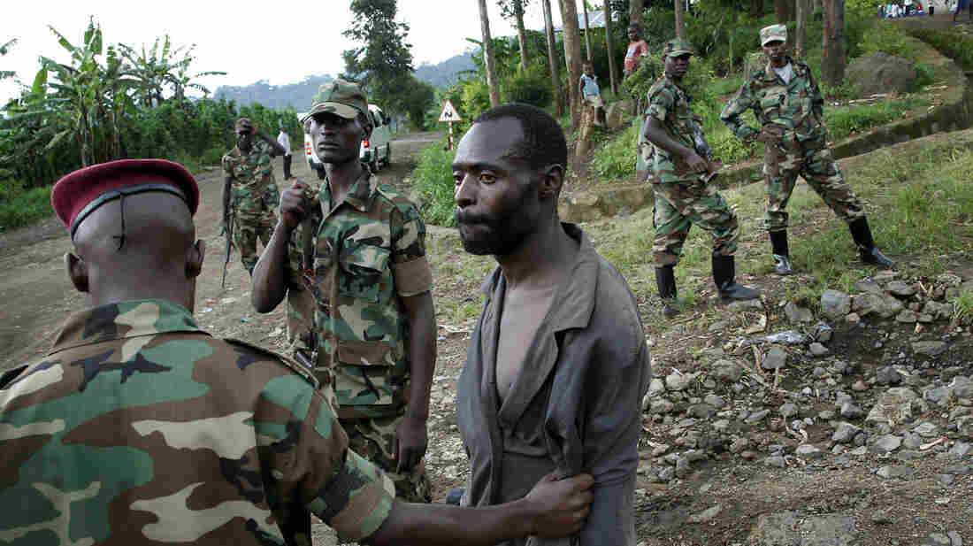 Congolese M23 rebel fighters detain a man they suspect to be an FDLR rebel returning from an incursion into Rwanda, north of Goma in the Democratic Republic of Congo, on Nov. 27, 2012. The 20-year conflict in Eastern Congo can feel like an alphabet soup of armed groups. An international team of diplomats is trying to stop the violence, one militia at a time.