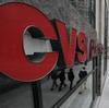 Pedestrians walk past a CVS store in Chicago.