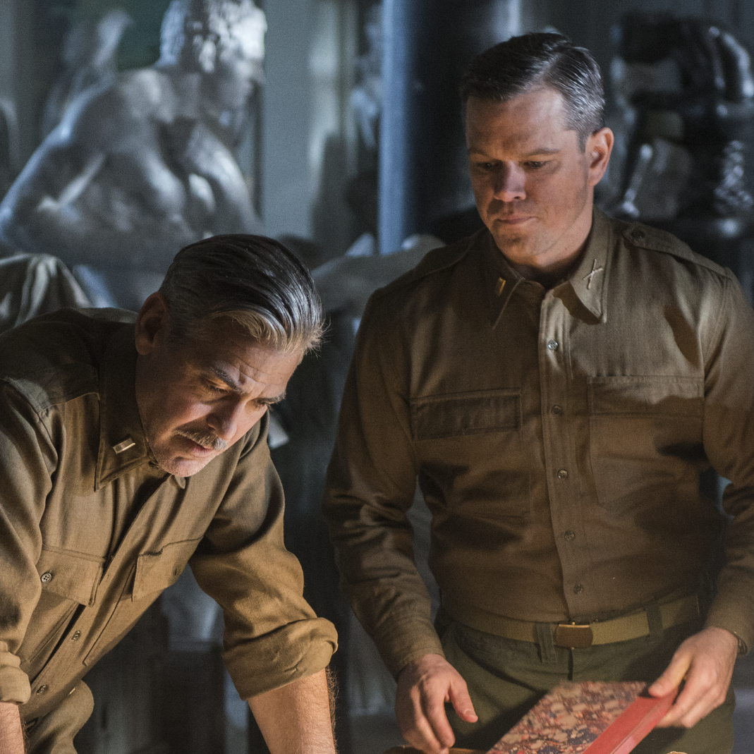 George Clooney (center) stars alongside Dimitri Leonidas, John Goodman, Matt Damon and Bob Balaban in the World War II drama The Monuments Men, inspired by the true tale of an Army unit charged with recovering art stolen by the Nazi regime.