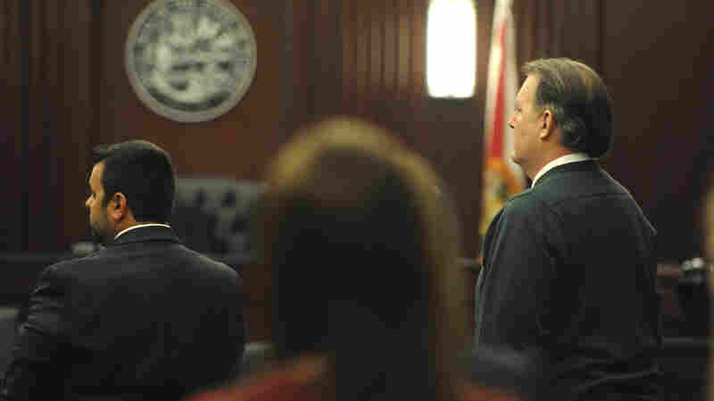 Michael Dunn (right), who faces first-degree murder charges in the death of 17-year-old Jordan Davis, stands with his attorney Cory Strolla (left) at Duval County Courthouse in Jacksonville, Fla., on Thursday.