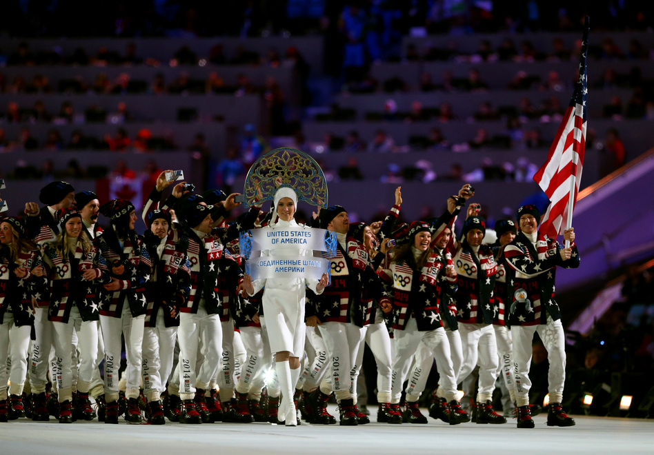Nordic combined skier Todd Lodwick carries the U.S. flag during the Parade of Nations. (Getty Images)