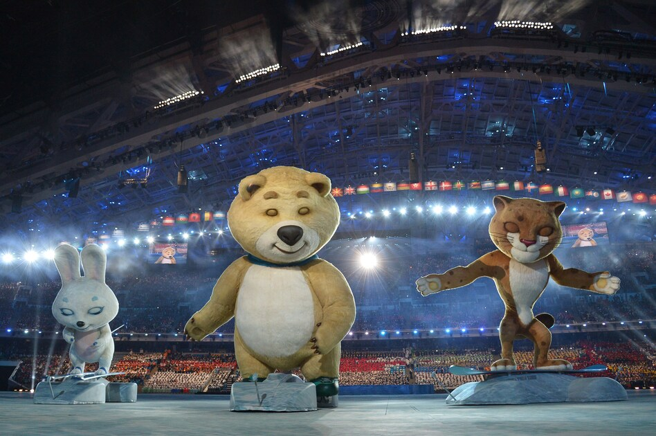 The 2014 Sochi Winter Olympics official mascots — the Leopard, the Polar Bear and the Hare — take part in the ceremony. (AFP/Getty Images)
