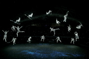 Images representing the Olympic gods are projected inside Fisht Stadium just before the lighting of the Olympic flame.