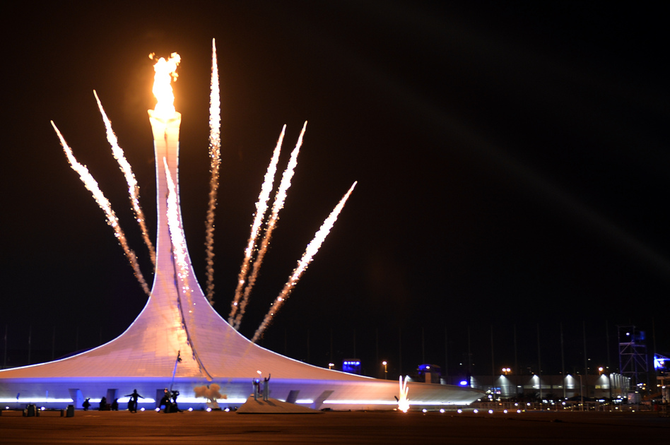 Fireworks explode behind the Olympic flame cauldron, announcing the official opening of the Winter Olympics in in Sochi, Russia. (AFP/Getty Images)