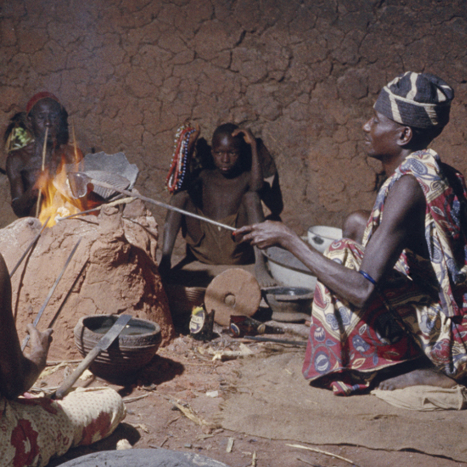 Nupe bead makers around glass-making furnace in 1959, Bida, Nigeria.