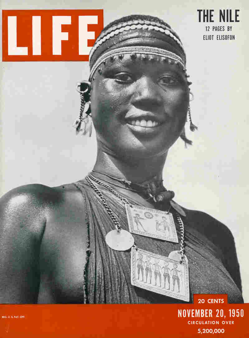 "This Shilluk woman appeared on the cover of Life magazine, The Nile issue, Nov. 20, 1950. Her pendants feature etchings of Sudanese village life. ""[They] are made out of aluminum that came from a downed airplane,"" Staples explains. Elisofon bought the pendant: He liked showing how the traditional mixed with the modern in African design and crafts."