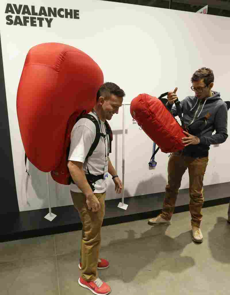 Derick Noffsinger models a deployed avalanche air bag pack made by Black Diamond at an industry market in Salt Lake City last month.