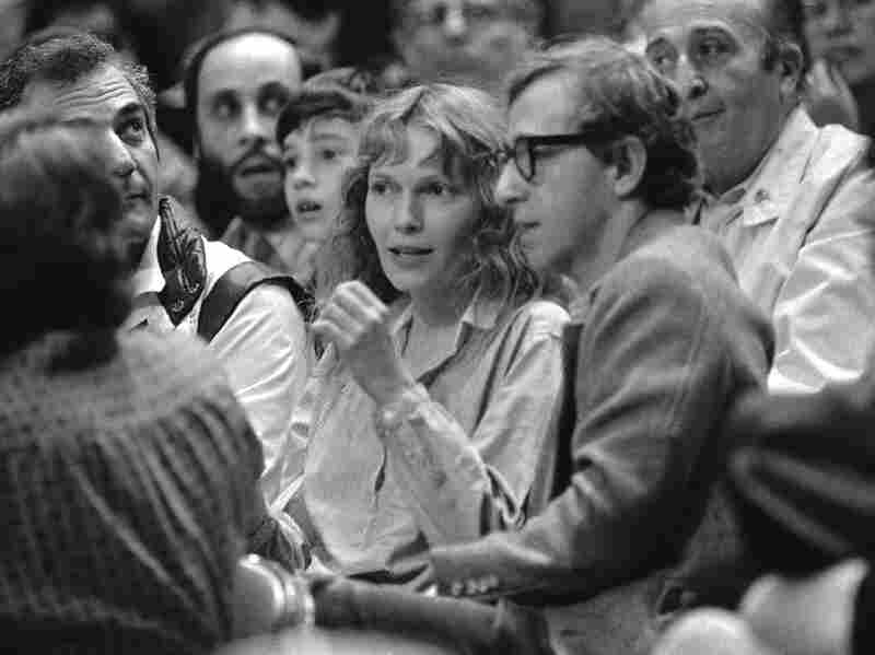 Mia Farrow and Woody Allen watch a basketball game in 1983. Dylan Farrow's statement alleging that Allen abused her was published online by a New York Times columnist.