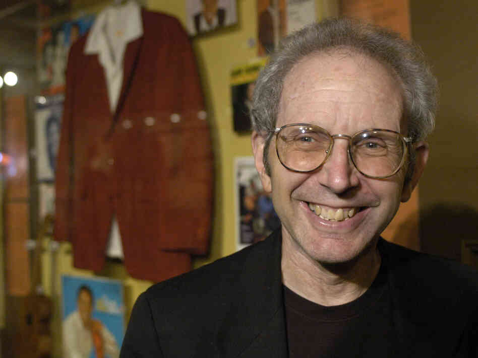 Author Peter Guralnick poses with Sam Cooke memorabilia at the Rock and Roll Hall of Fame, in Cleveland, Ohio, on Nov. 4, 2005.