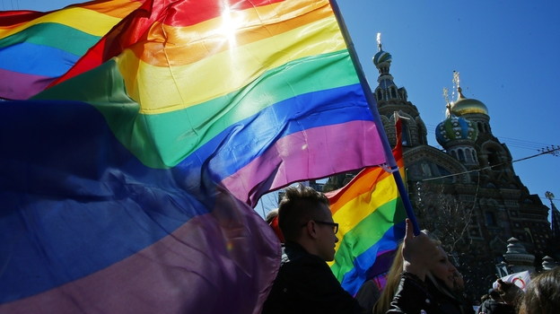 Gay rights activists carry rainbow flags as they march during a May Day rally in St. Petersburg, Russia, in May of 2013. (AP)