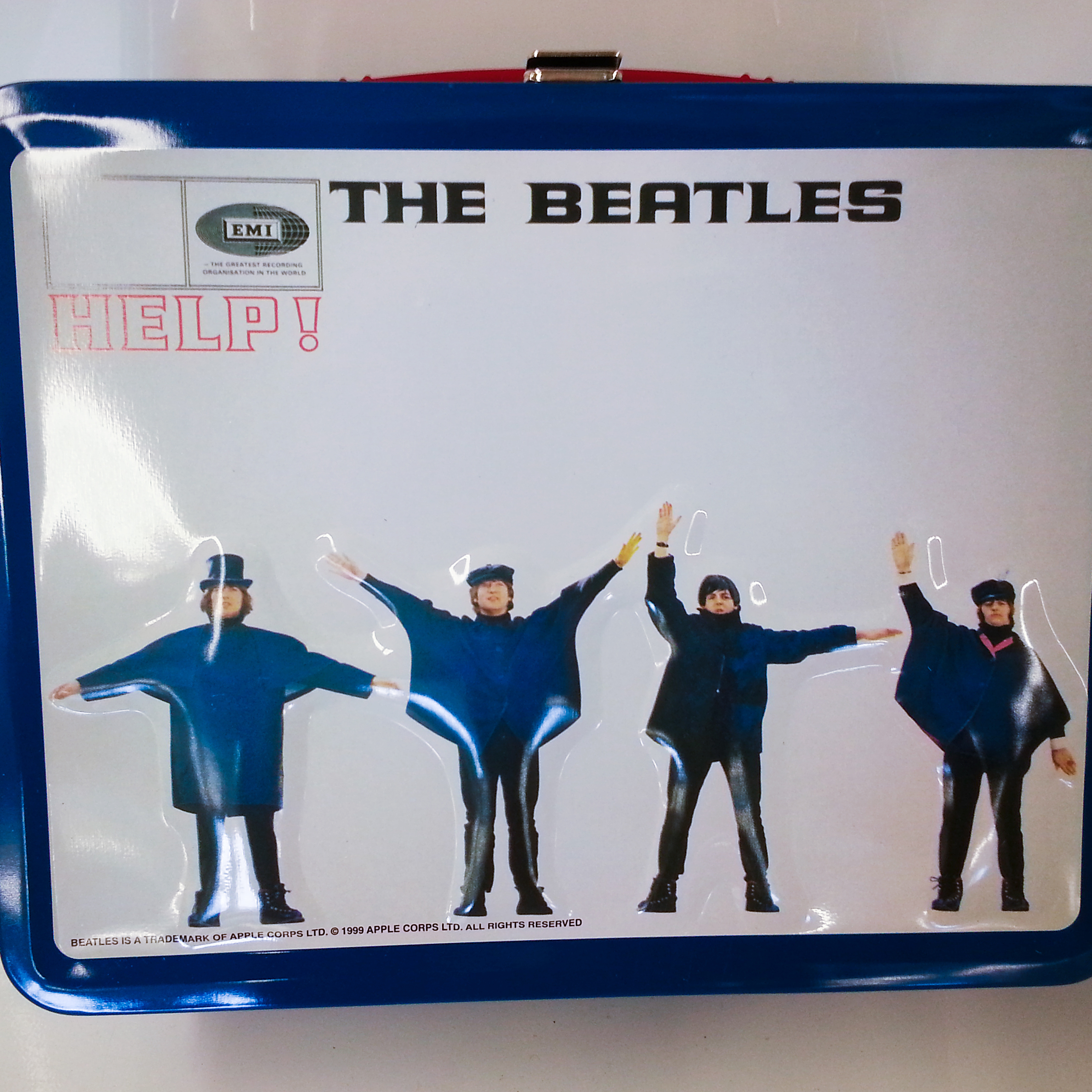 While an original Beatles lunchbox will cost you hundreds of dollars, fans can pick up a version made in the '90s or later in the $10-$25 range. Here's one based on the 1965 album Help! It's being sold on eBay as part of a set of 13 lunchboxes, each based on a different Beatles album cover.