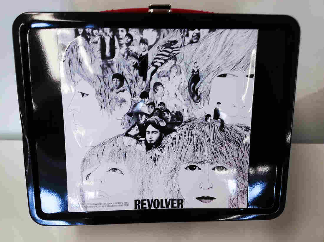 The Beatle's 1966 album Revolver is depicted on a retro-style, modern metal lunchbox.