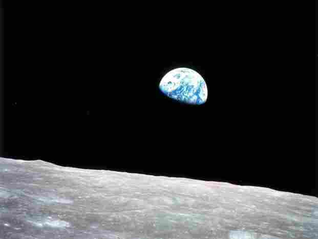"""Taken by Apollo 8 astronaut Bill Anders on Dec. 24, 1968, the """"Earthrise"""" photo gave humans a view of their home unlike any they'd ever seen. On average, the moon is about 240,000 miles from Earth."""