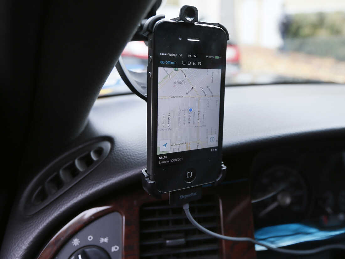 Image #: 26305792 Transportation app Uber is seen on the iPhone of limousine driver Shuki Zanna, 49, in Beverly Hills, California, December 19, 2013. Photo taken December 19, 2013. REUTERS/Lucy Nicholson (UNITED STATES - Tags: BUSINESS TRANSPORT) REUTERS /LUCY NICHOLSON /LANDOV