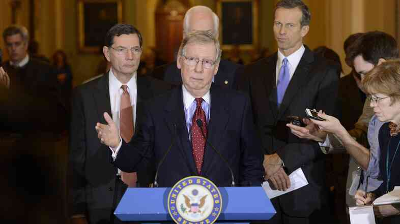 Senate Minority Leader Mitch McConnell delivers remarks  during a news conference