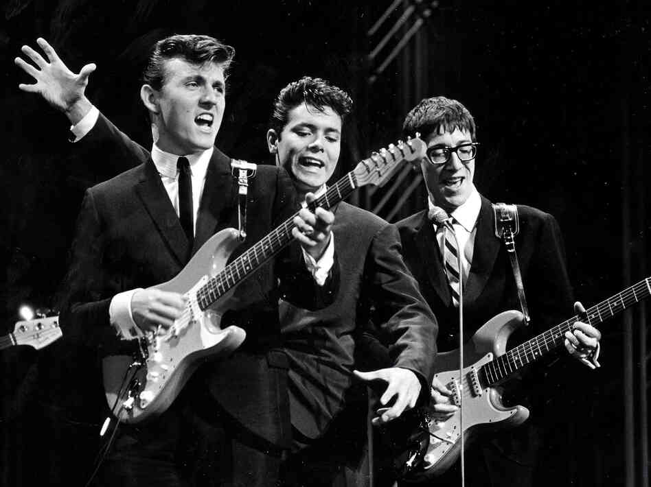 The Shadows on stage in the 1960s. The British rock act, formed as a backing band for singer Cliff Richard (center), was among the U.K. acts who stayed behind as The Beatles and others were cresting in America.