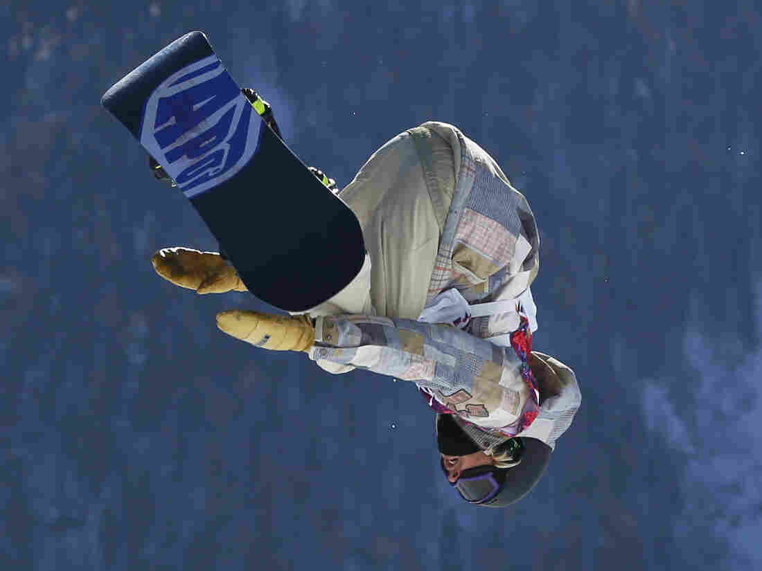 United States' Sage Kotsenburg takes a jump during the men's snowboard slopestyle final at the Rosa Khutor Extreme Park, at the 2014 Winter Olympics, on Saturday.