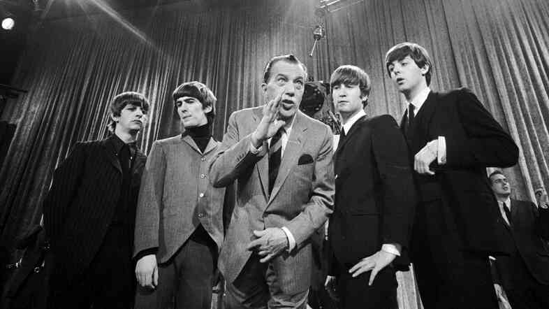 Ed Sullivan (center) stands with The Beatles during a rehearsal for the British group's first American appearance, on the Ed Sullivan Show, in New York on Feb. 9, 1964.
