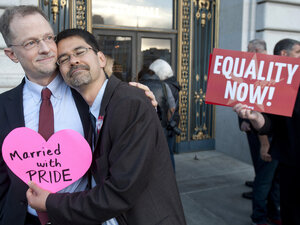 John Lewis (left) and Stuart Gaffney embrace outside San Francisco's City Hall shortly before the U.S. Supreme Court ruling cleared the way fo
