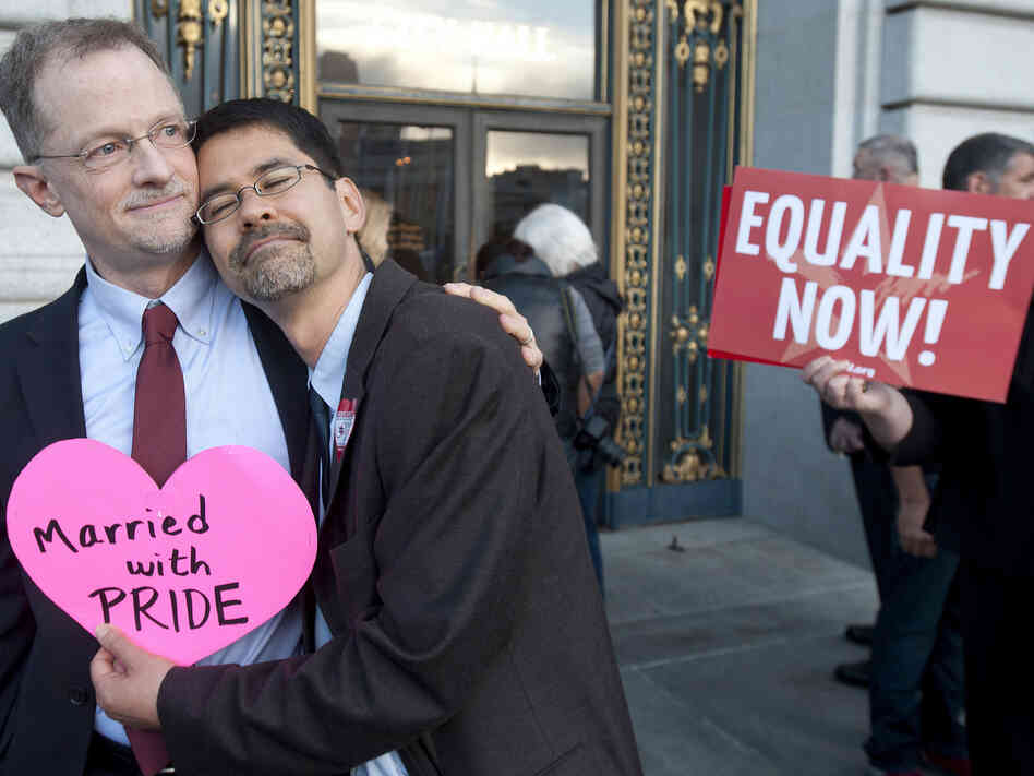 John Lewis (left) and Stuart Gaffney embrace outside San Francisco's City Hall shortly before th