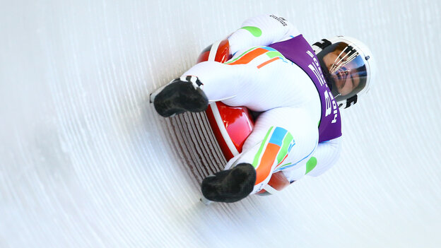 Independent Olympic participant Shiva Keshavan makes a run during the men's luge training session ahead of the Sochi 2014 Winter Olympics at the Sanki Sliding Center on Wednesday in Sochi, Russia.