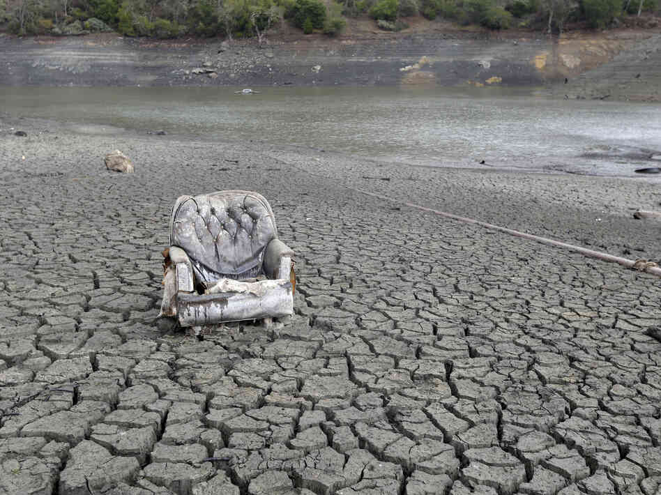 The cracked-dry bed of the Almaden Reservoir is seen on Friday, in San Jose, Calif.