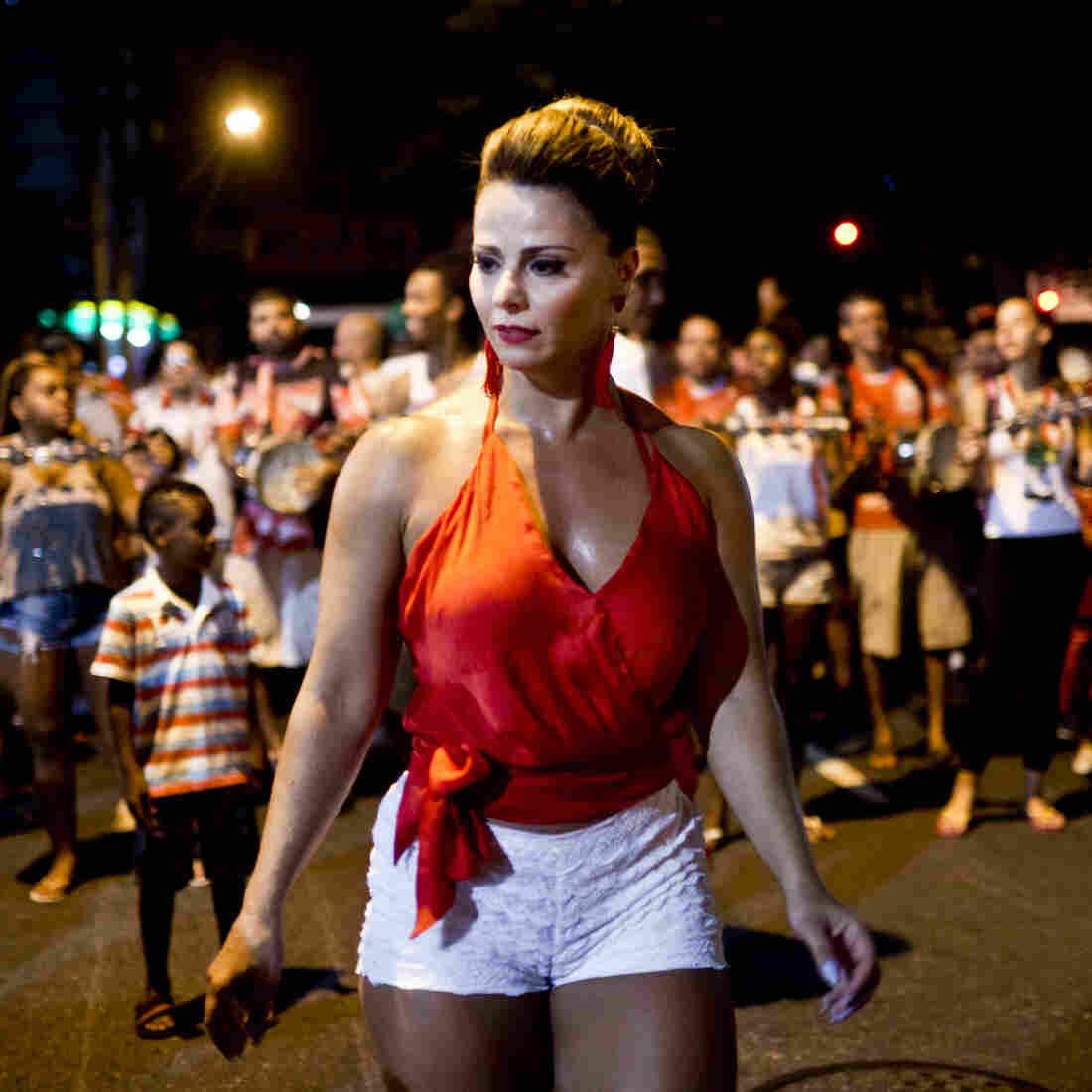Viviane Araujo, a Salguiero samba school queen, performs at a rehearsal for Carnival in Rio de Janeiro. Marcello da Cunha Freire, vice president of the popular samba school, was murdered last month in a drive-by shooting.