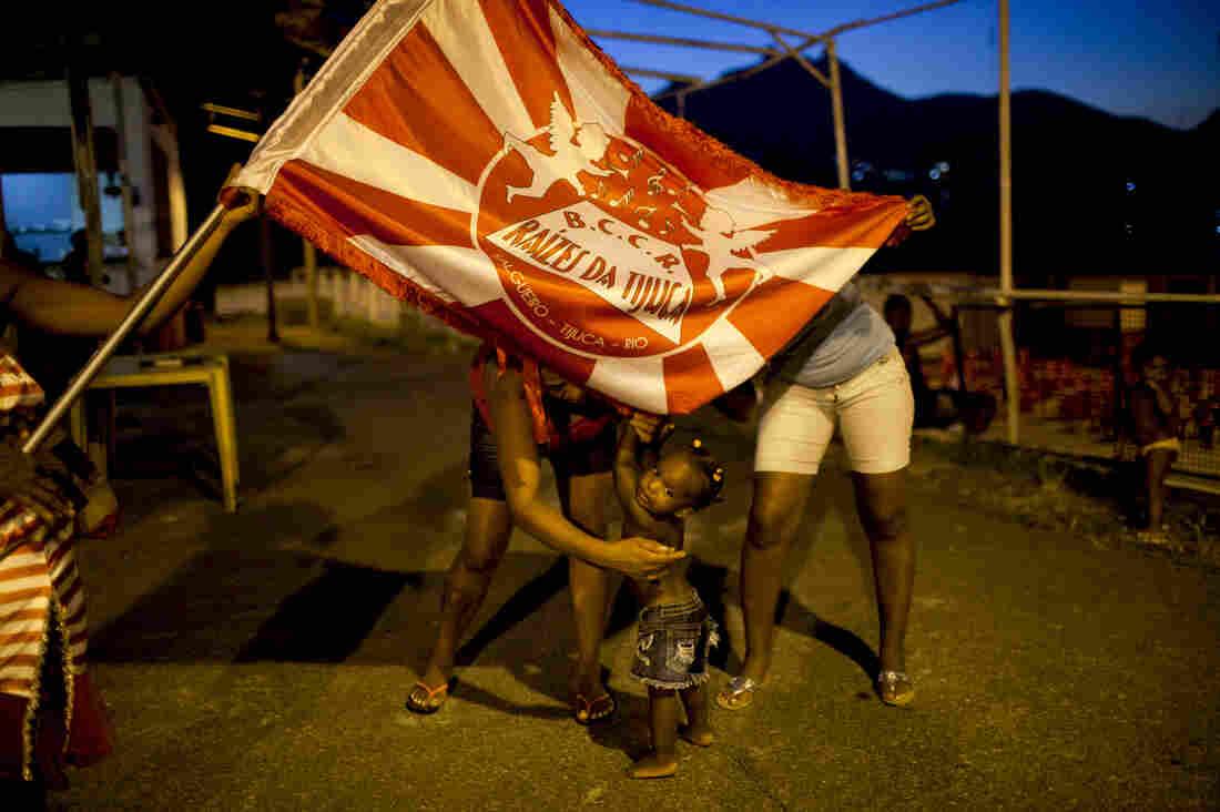 Residents hang out in Salgueiro, where the Salgueiro samba school has a smaller, informal samba group called Raizes Da Tijuca.