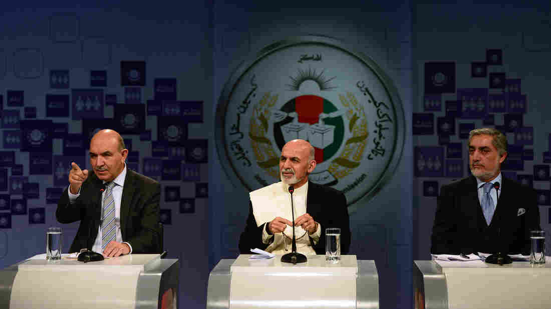 Afghan presidential candidates Qayum Karzai (from left), Ashraf Ghani and Abdullah Abdullah take part in a televised debate in Kabul on Saturday. With President Hamid Karzai stepping down, the presidential election set for April 5 will mark the first time the country has changed