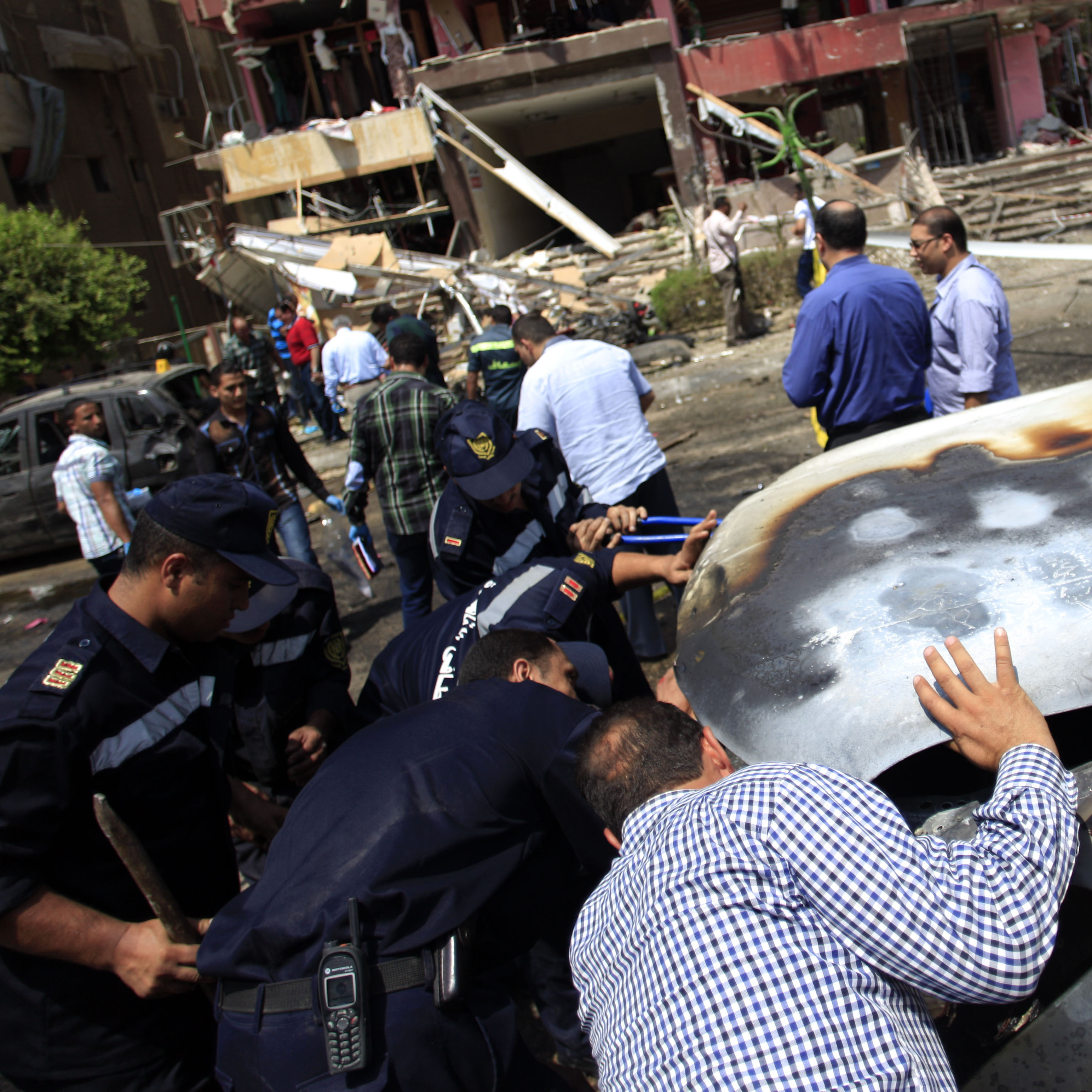Security forces check a car damaged by a bomb in an attack on the convoy of Egypt's Interior Minister Mohammed Ibrahim, in Cairo, on Sept. 5. The militant group Ansar Beit al-Maqdis claimed responsibility.