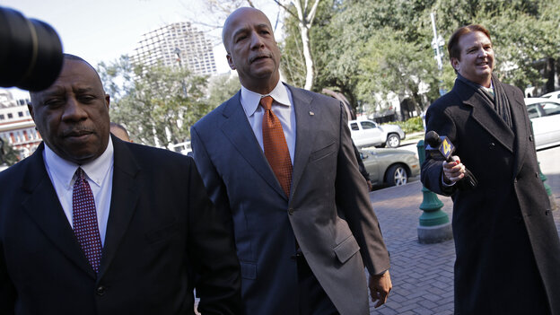 Former New Orleans Mayor Ray Nagin enters court for his corruption trial in New Orleans last month. He was charged with accepting bribes, free trips and other gratuities from contractors in exchange for helping them secure millions of dollars in city work.