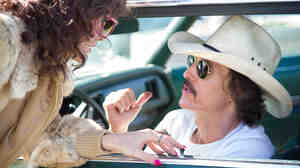 Rayon (Jared Leto) and Ron Woodroof (Matthew McConaughey) are fellow AIDS patients smuggling alternative medications into the U.S. in Dallas Buyers Club, directed by Jean-Marc Vallée.